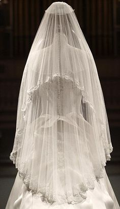 The beauty is in the detail: Kate's veil is made of soft ivory silk tulle and stitched with flowers