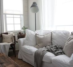 Cozy corner at the cottage - I like the old mixed with the new in a modern, neutral way.