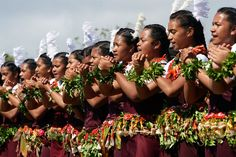 Tonga people in a line looking like they are about to dance.