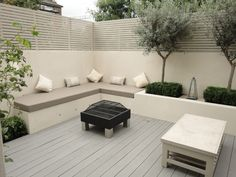 Modern built in planters with l shaped bench seating around fire pit