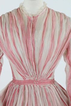 Pink and white striped muslin summer gown, circa 1864.