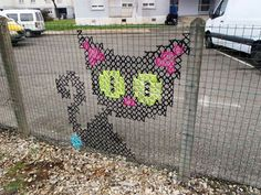 Creative-Street-Art-Cross-Stitch-Murals-on-Fences-2.jpg