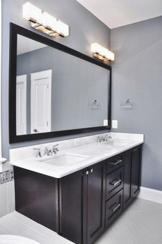 Bathroom Charming Bathroom Lighting Fixtures Over Mirror: Elagant Grey Wall And Dark Wood Cabinet With Bathroom Light Fixtures Over Big Mirror And White Marble Double Sink Chrome Faucet