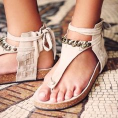 "NWOT Free People Collins Footbed Sandal NWOT Free People Collins Footbed in Beige. Size 39, or US size 8. Never worn. ""Soft suede footbeds with a strappy embellished ankle wrap and thong shape. Color: Stone"" Free People Shoes Sandals"