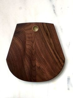 x x solid walnut brass inlaid round hole for hanging half moon bottom with two tapered sides beveled top & bottom perimeters Gifts For Friends, Gifts For Mom, Wooden Chopping Boards, Diy Woodworking, Wood Design, Gift Guide, Carving, Cheese Boards, Entertaining