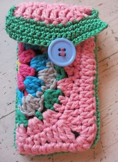 Crochet cozy, NO pattern, however, it looks like a large granny square folded in half with edging. It is adorable! Again, no specific pattern, but it is adaptable. Charming idea