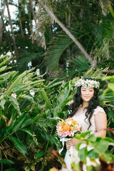 Photography: Aria Studios - ariastudios.com   Read More on SMP: http://www.stylemepretty.com/destination-weddings/hawaii-weddings/2016/07/15/best-wedding-backdrop-ever/