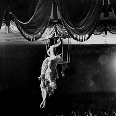Yale Joel - Night club dancer performing a bird cage scene. New York, May 1958. S)