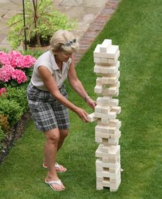 Outdoor Jenga type game. Great for kids and adults:)  looks a little dangerous to me, but fun   I WILL BE MAKING THIS OUT OF 2BY 4S