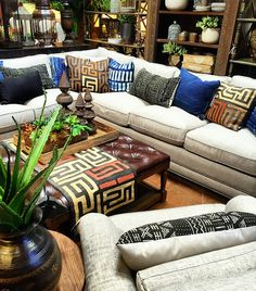 Boho Luxe living room with African textiles and leather ottoman - Kuba cloth, mudcloth, and indigo  Tierra Del Lagarto - Scottsdale Furniture Store