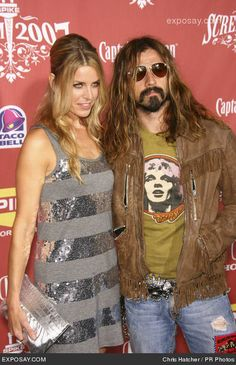 Sherri Moon Zombie and Rob Zombie.  They got married on halloween and he puts her in all his movies. love them    Google Image Result for http://www.exposay.com/celebrity-photos/sheri-moon-zombie-and-rob-zombie-spike-tvs-screem-2007-awards-Mi59iE.jpg