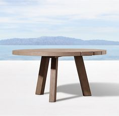 RH's Merida Round Dining Table:Created by Belgian designer Xavier Van Lil, this collection takes inspiration from the classic 1950s slipper chair. Composed of bold teak timbers acutely angled to maximize both aesthetics and ease, the low profile and clean lines evoke a singularly minimalist point of view.
