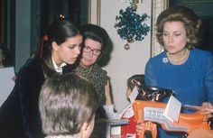 Princess Grace of Monaco and her daughter Princess Caroline handing out Christmas presents to the children on Monaco in 1971.