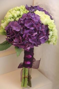 Purple & Green Hydrangea Bouquet, I really like the green mixed in. I think it really lightens it up. Gives it a fresh feel. Maybe each girl has a different color hydrangeas? Purple And Green Wedding, Purple Wedding Flowers, Floral Wedding, Wedding Bouquets, Bridesmaid Bouquets, Bride Flowers, Green Flowers, Dark Purple, Purple Hydrangea Bouquet