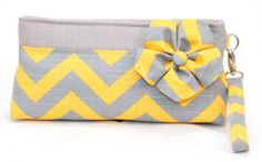Both the pattern and colors of this large wristlet clutch would be a great addition to any outfit.  $68.00