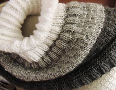 A cozy cowl big enough to cover neck and shoulders. Ribbed neck can be worn up or folded down.