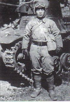 A japanese army tank commander posing with his Type 95 Ha-go light tank during the great Ichi-go offensive (china, september 1944)