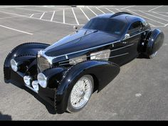 The Bugatti was unveiled in Paris in 1991 and went into production until Bugatti went out of business in 1995 (Bugatti has since been resurrected by Volkswagen). The car was available as a two-door sports car and only 31 cars were produced. Bugatti Cars, Bugatti Veyron, Vintage Cars, Antique Cars, Hot Rods, Amazing Cars, Car Car, Sexy Cars, Motor Car