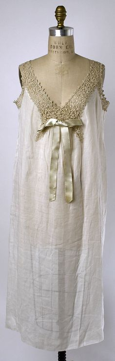 Chemise Date: ca. 1890 Culture: French Medium: cotton Dimensions: Length at CB: 41 in. (104.1 cm) Credit Line: Gift of Mrs. Jan Juta, 1950 Accession Number: C.I.50.23.2