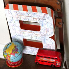 DIY map covered monogram- cover with football plays for Brooks' room