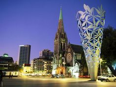 "Cathedral Square, Christchurch, New Zealand - New meets old in Cathedral Square, center of Christchurch. The largest city on South Island, Christchurch has been called ""the most English city outside England."""