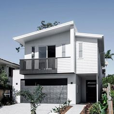 This mixed materials design puts a spin on the classic coastal home, using clean, crisp lines to achieve a modern finish. Perfect for a harbourside abode!  Photo by: Cathy Schusler Home by: Kalka Homes     #australianarchitecture #architecture #exterior #exteriordesign #scyonwalls