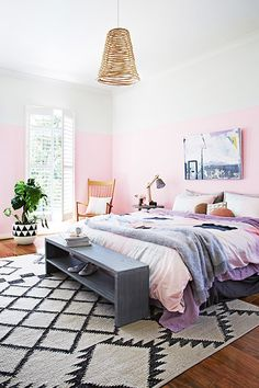 i love the idea of this bedroom being 'wainscoated' but just with paint on three quarters of the way up the walls, rather than actual molding. it makes the room feel really light and airy with the solid white above — the light seems to bounce of the upper walls and ceiling almost like the room is glowing. while pretty colorful, it's still very soft and feminine. | living in pink - sfgirlbybay