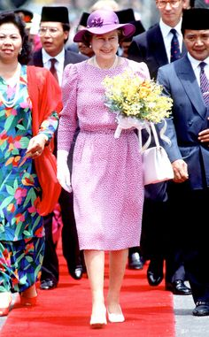 1989 from Queen Elizabeth II's Royal Style Through the Years  The Queen looked lovely in lavender print while on an official visit to Ipoh, Malaysia.