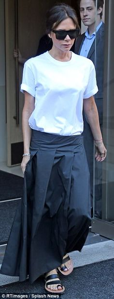 On Friday: Victoria favoured the same white t-shirt, teaming it with voluminous navy trous...