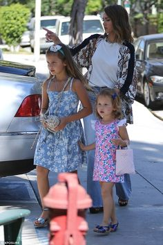 Growing up fast: Both Honor and Haven wore mini heeled sandals with their pretty dresses...