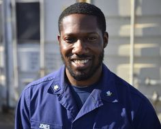 Petty Officer 3rd Class Darius Jones, a generally modest, mild mannered coastie, walks around the Customs and Border Protection facility in Yuma, Arizona with a bright smile, greeting everyone with a fist bump and uplifting comment. Patriotic Poems, Coast Guard, Chef Jackets, Yuma Arizona, Fist Bump, Articles, Walks, Mens Tops, Smile