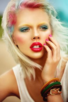 attractive young model with bright makeup and manicure sunny weather, outdoor, sunburn
