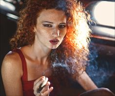 Lady with lush curly hair sits in car and smokes #hot #sexy #hairstyles #hairstyle #hair #long #short #buns #updo #braids #bang #blond #wedding #style #haircut #bridal #curly #bride #celebrity #black #white #trend #bob #girl #pantyhose #stockings #bikini #legs