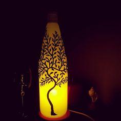 Upcycled wine bottle tree lamp