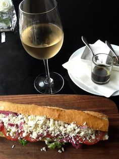 Delicious glass of Haute Cabriere Chardonnay Pinot Noir with a goat cheese, tomato and basil baguette Beso de Vino