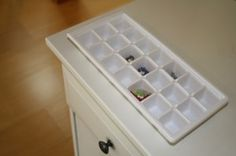 Use an ice cube tray to hold jewelry in a bedside table drawer. Check our other top ten favorite organizing products from the pros on our blog!