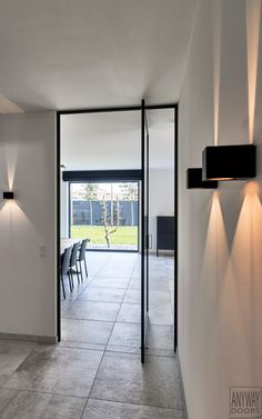 Modern glass and aluminium pivot door with invisible pivoting hinges. Glass And Aluminium, Pivot Doors, The Doors, Modern Glass, Design Awards, Decoration, Bad, Indoor, Flooring