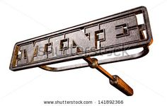 A metal cattle brand with the word mine as the marking area on an isolated background - stock photo