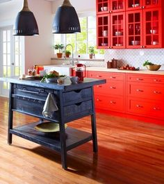 Bright reds echo ripe organic ingredients to energize a busy space such as a kitchen. New Kitchen, Kitchen Dining, Kitchen Decor, Kitchen Ideas, Kitchen Lamps, Kitchen Island, Dining Room, Valspar Paint, Home Board