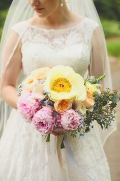 Romantic spring bouquet with pink peonies, tree peonies, garden roses, and greenery | Photo by J. Woodberry Photography