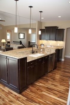 We love the #kitchen island! Also the dark cabinets go well with the medium colored wood flooring! www.remodelworks.com