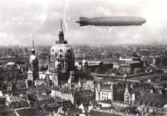 "Airship LZ-127 ""Graf Zeppelin"" flying over Berlin in the late 1920s/early 1930s. Visible in this photo are the Berliner Dom with its original ""lanterns"", the ""Museum Insel"" with the Pergamon and Kaiser Friedrich museums (Alte Nationalgalerie, Neues Museum, Bode Museum)."