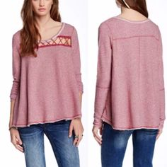 Free People Lacy Love Pullover A swingy tee fashioned from a stretch-cotton blend is styled with a lace-up cutout at the front yoke. Nautical stripes and reverse seams accentuate the offbeat vibe. Free People Tops Sweatshirts & Hoodies