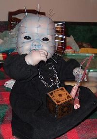 creepy doll.... maybe this is what my doll in a cage should look like?