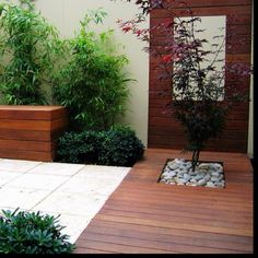 Backyard deck and planter - love the mix of textures and colours and materials used...