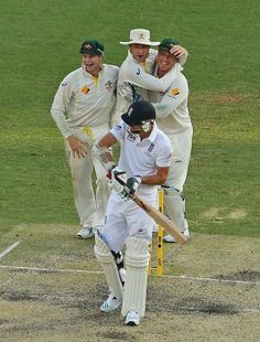 Australia v England - First Test: Day 4 - Steven Smith, Michael Clarke and Brad Haddin celebrate as last man out James Anderson of England is dismissed during day four of the First Ashes Test match between Australia and England at The Gabba on November 24, 2013 in Brisbane, Australia. (Photo by Scott Barbour/Getty Images)