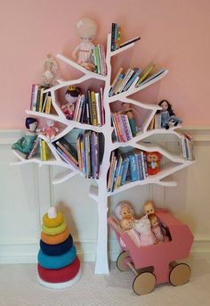 Our popular tree bookcase creates a stunning display in this girly nursery