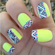 These nails are yellow with a beautiful detail on them. Perfect for a hot summer day.