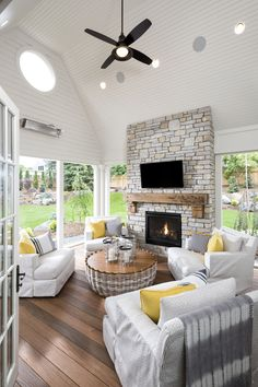 This Artisan is perfect if you are looking to add a little bit of style to your farmhouse sunroom. The fireplace stone and overall color of the room, compliment each other really well. Outdoor Living Rooms, My Living Room, Cozy Living, Living Spaces, Porch Fireplace, Fireplace Stone, Deck With Fireplace, Fireplace Hearth, Indoor Outdoor Fireplaces