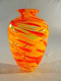 Small orange yellow hand blown glass flower vase by Glassometry, $70.00